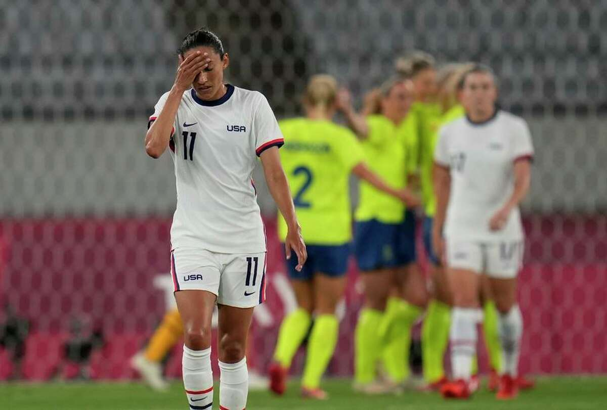 U.S. forward Christen Press seems in disbelief after Sweden players celebrates their third goal Wednesday in Tokyo.