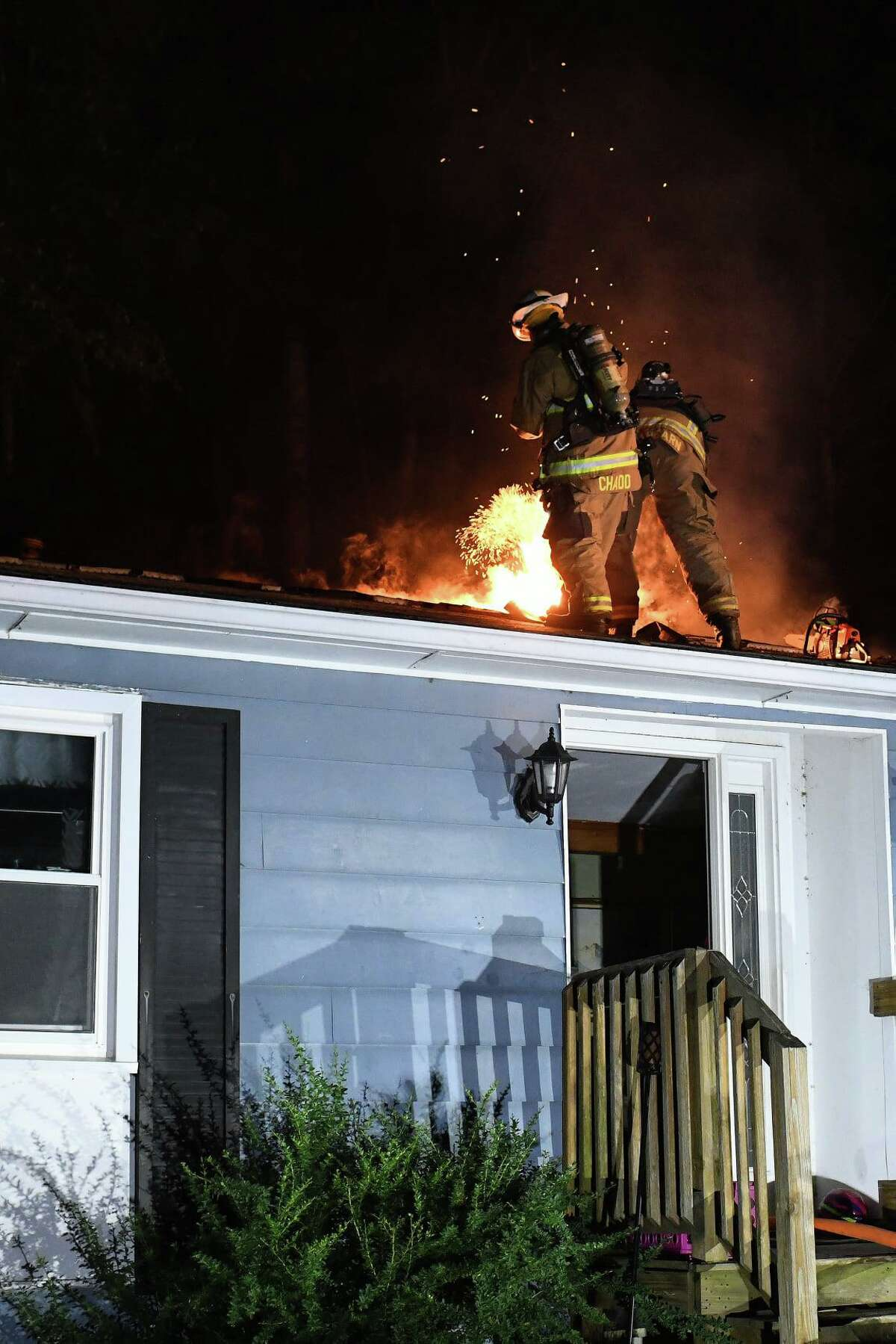 Crews battle a fire at a Chamberlain Hill Road home in Haddam, Conn., on Saturday, July 17, 2021.