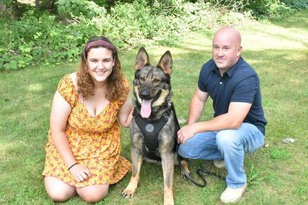 From left to right: Brittany Murphy of West Haven, police K-9 Magnus and Portland Police Sgt. Jim Kelly. Murphy raised $1,200 to donate a bulletproof vest to Magnus.