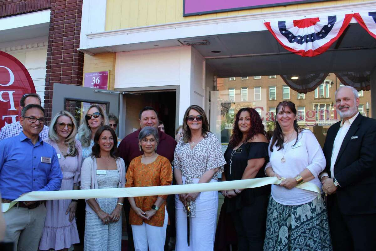 From left, Joel Grossman, Bridie Bradbury, Kristin Daly-Murphy, Daniela Volo, Antonio Liguori, Maryann Taylor, Beth Allen-Byrd, Nikki Trocchio, Jennifer DeVivo and Ray Andrewsen, executive director of the Quinnipiac Chamber of Commerce, attend a ribbon-cutting for the new offices of Calcagni Real Estate on North Main Street in Wallingford.