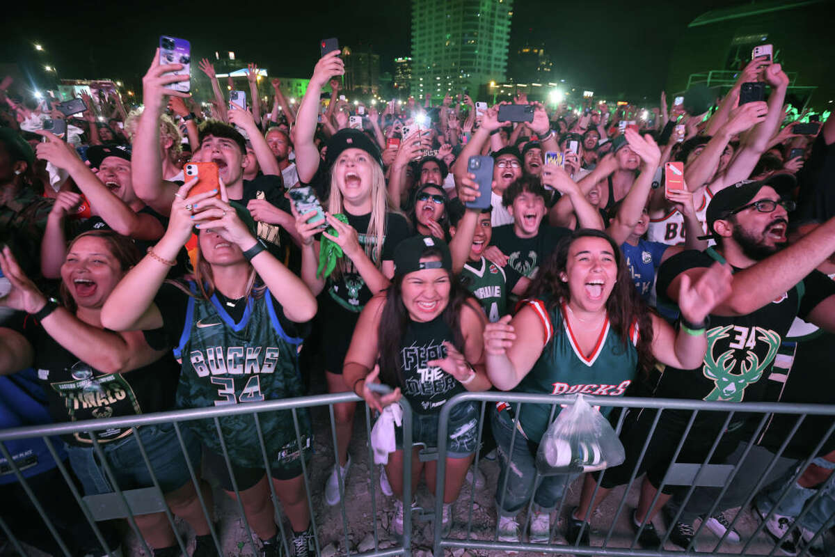 MILWAUKEE, WISCONSIN - JULY 20: Fans celebrate outside Fiserv Forum as the Milwaukee Bucks defeat the Phoenix Suns in game 6 of the NBA Finals to win the championship on July 20, 2021 in Milwaukee, Wisconsin. This was the first championship for the Bucks in 50 years.