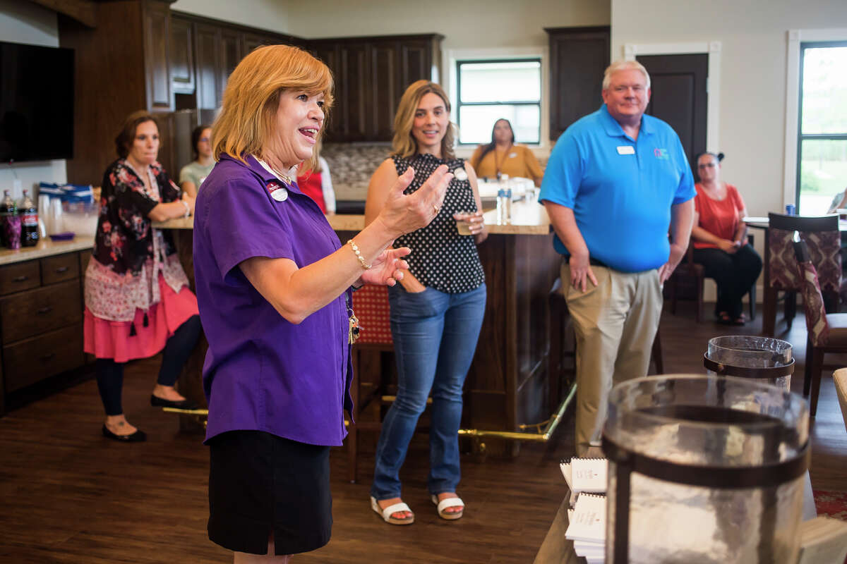 Jane Johnson, sales director for Primrose Retirement Community and co-chair for this year's Walk to End Alzheimer's, speaks during a kick off party Tuesday, July 20, 2021 for the walk, which is scheduled to take place Saturday, Oct. 9 at Dow Diamond. (Katy Kildee/kkildee@mdn.net)