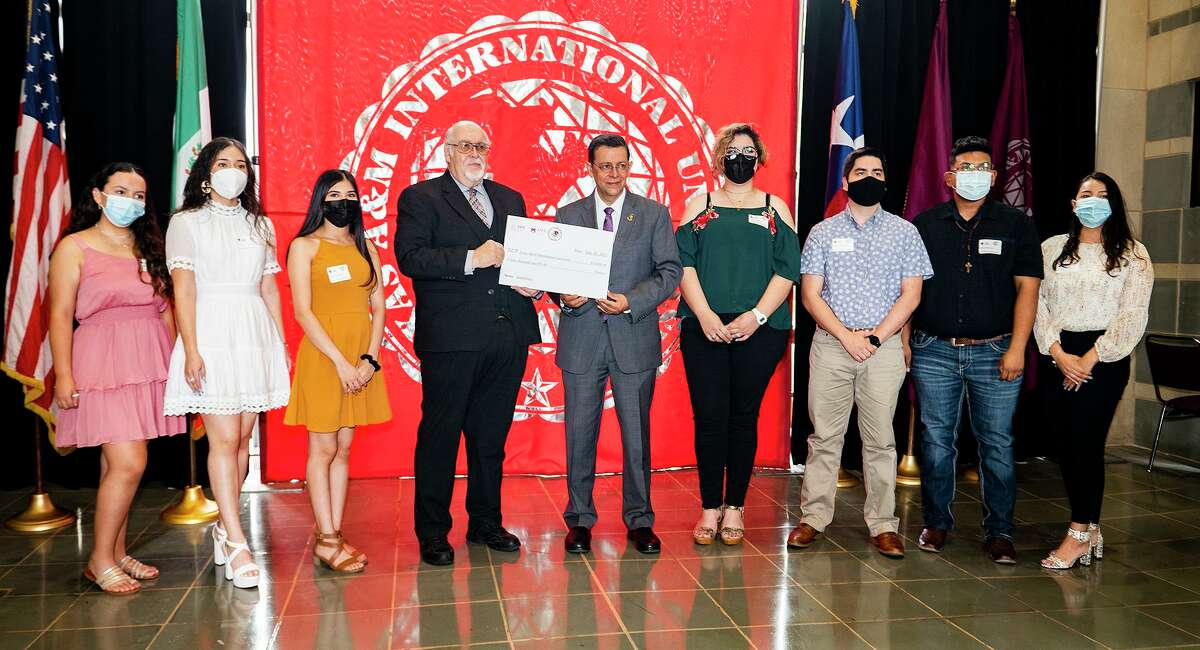 TAMIU President Pablo Arenaz and Consul General of Mexico Juan Carlos Mendoza Sanchez gather with scholarship recipients after signing a memorandom of understanding on Tuesday, July 20, 2021 for the Institute of Mexicans in the Exterior (IME) BECCAS scholarship program at TAMIU.