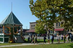 The Gilmore Girls Fan Festival attendees stop by the gazebo on the green in New Milford during a bus tour stop in downtown New Milford, Conn. Saturday, September 28, 2019.