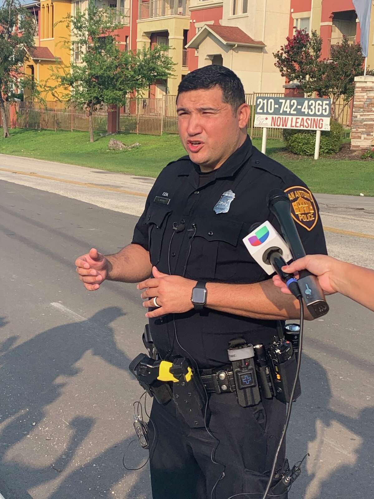 A man suspected of critically wounding another man during a shooting Wednesday morning has barricaded himself inside an apartment on the Southwest Side, San Antonio police said. In this photo, SAPD spokesman Chris Ramos speaks to journalists.