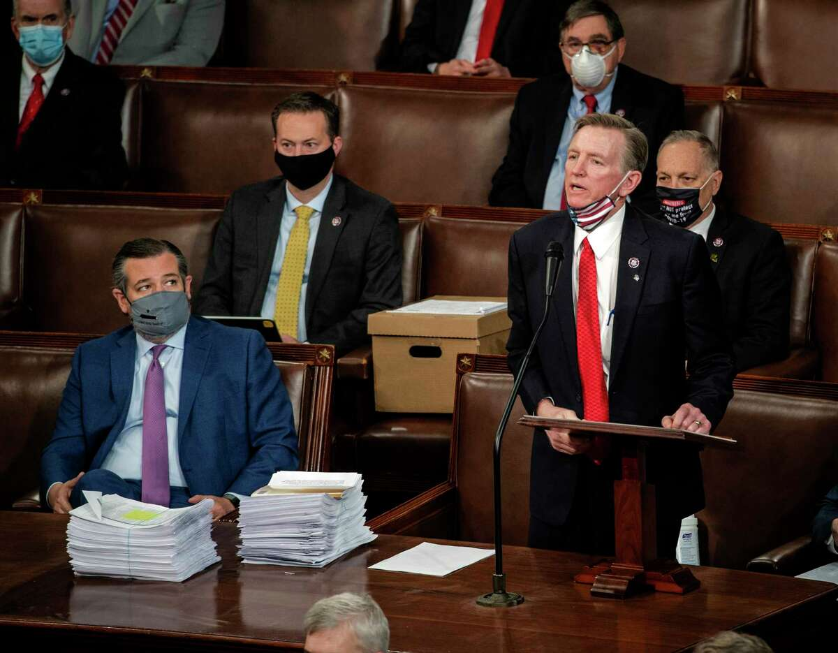 Rep. Paul Gosar, R-Ariz., stands to object to the certification of his state's election results during the Congressional joint session to certify the presidential election results on Jan. 6, 2021.