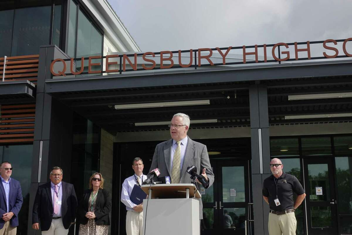 With area school superintendents seen behind him, State Senator Dan Stec speaks at a press conference outside of Queensbury High School on Wednesday, July 21, 2021, in Queensbury, N.Y. The school superintendents along with Senator Stec are asking the governor to release guidance on how schools will be able to operate this fall. (Paul Buckowski/Times Union)
