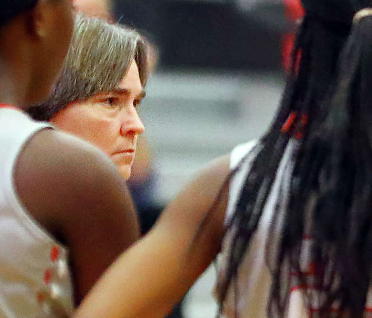 Tammy Talbert has been named the head coach of the boys and girls cross country teams at Alton High School. Talbert, a longtime girls basketball coach, has directed Alton, Marquette and Roxana girls basketball teams. She is shown on the AHS bench during a girls basketball game.