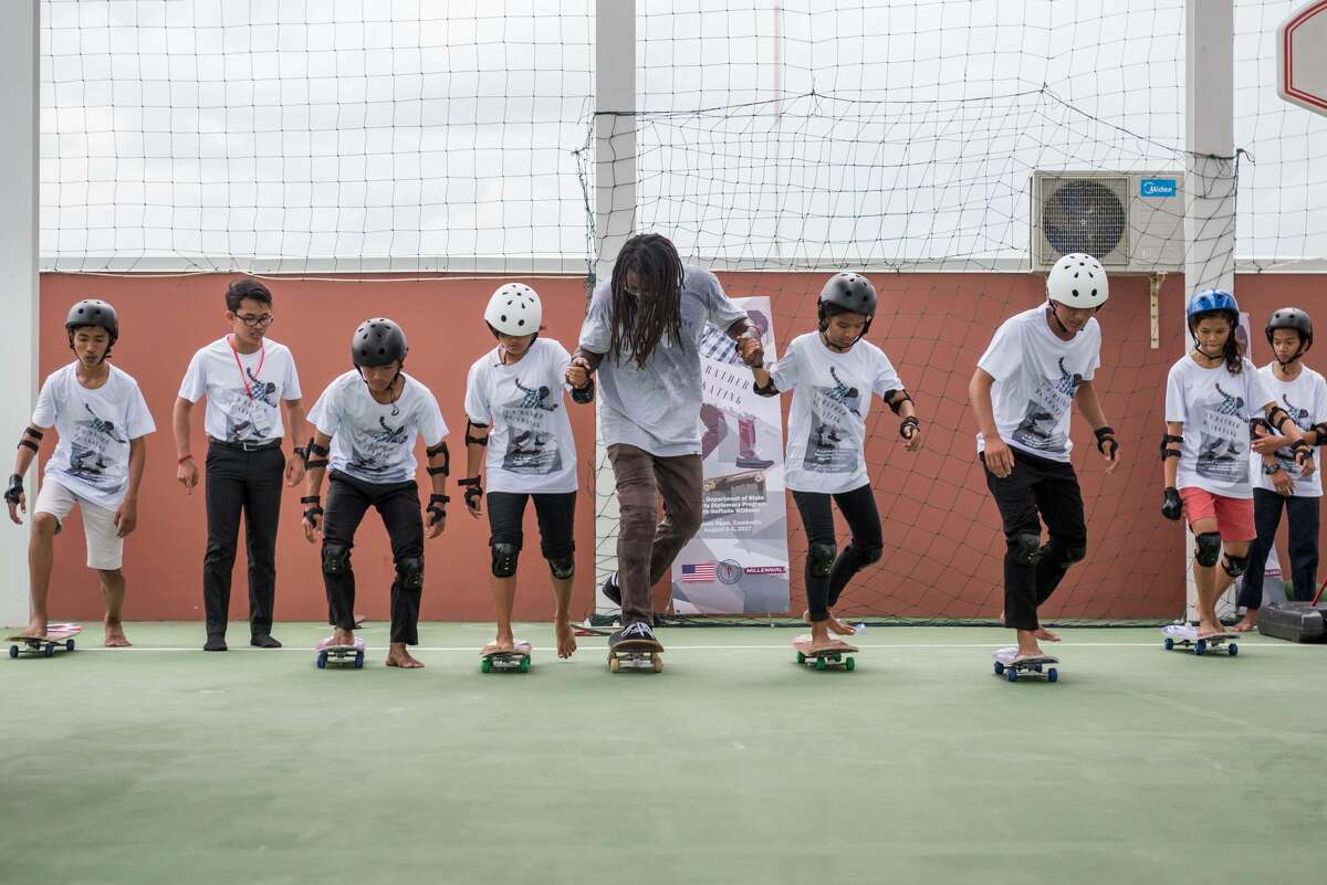 Neftalie Williams is seen teaching young Cambodian skaters. Williams was the first U.S. sports envoy for skateboarding and used the sport to promote unity with young people in Cambodia, Brazil and Cuba.