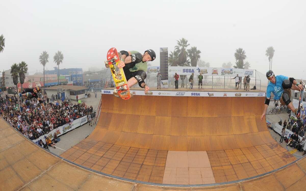 Skateboarders Mitchie Brusko (left), Tony Hawk and Andy Mcdonald.
