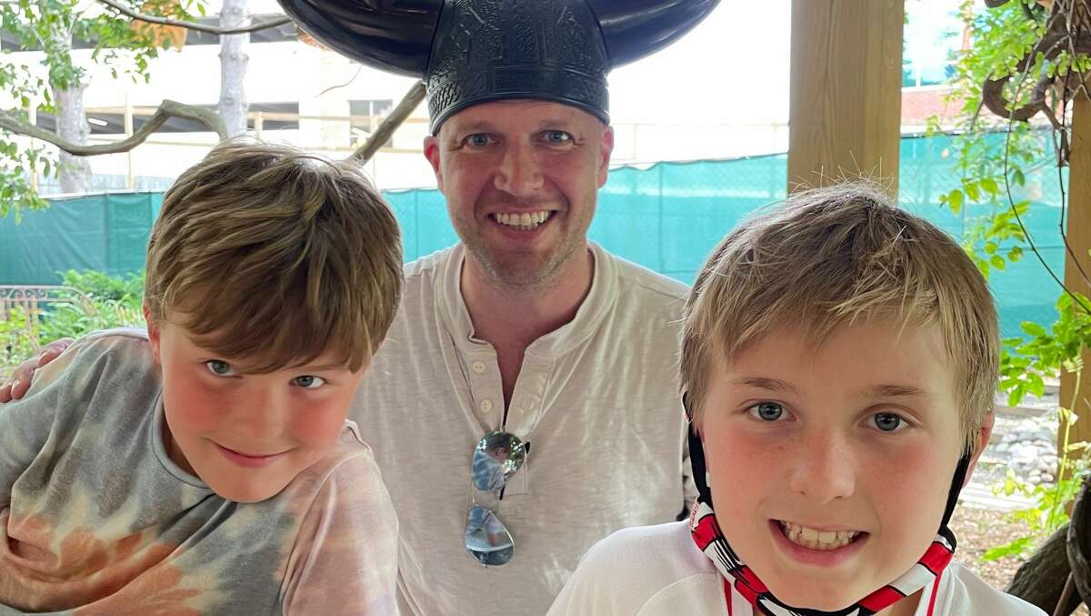 Mark Graydon with his sons Charlie, left, and Leo. The twins, who were 14 months old when their father was diagnosed with brain cancer, turn 9 next month. (Provided photo.)