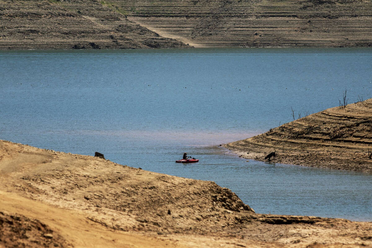A kayaker on the water at Lake Oroville, which stands at 33 percent full and 40 percent of historical average when this photograph was taken on Tuesday, June 29, 2021 in Oroville, CA.