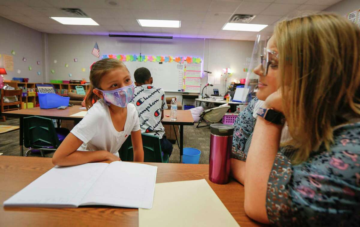 Reyna Johnson visits with her 3-grade teacher Kirston Boston at Humble Elementary School Monday, Aug. 24, 2020, in Humble.