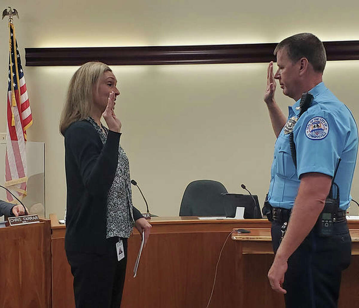 City Clerk Michelle Boyer, left, swears in new Edwardsville Police Chief Michael Fillback Tuesday during the city council meeting.