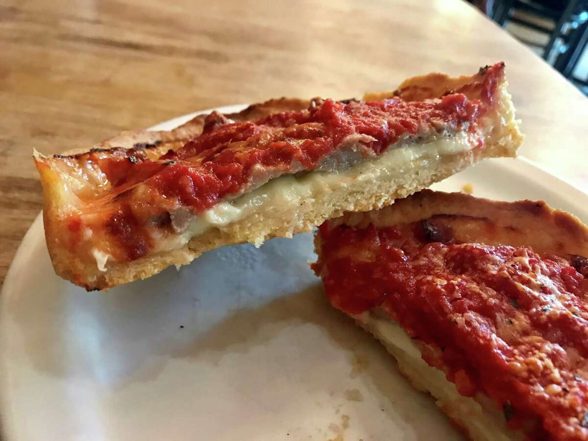 Individual deep dish Chicago Classic pizza with sausage at Lou Malnati's