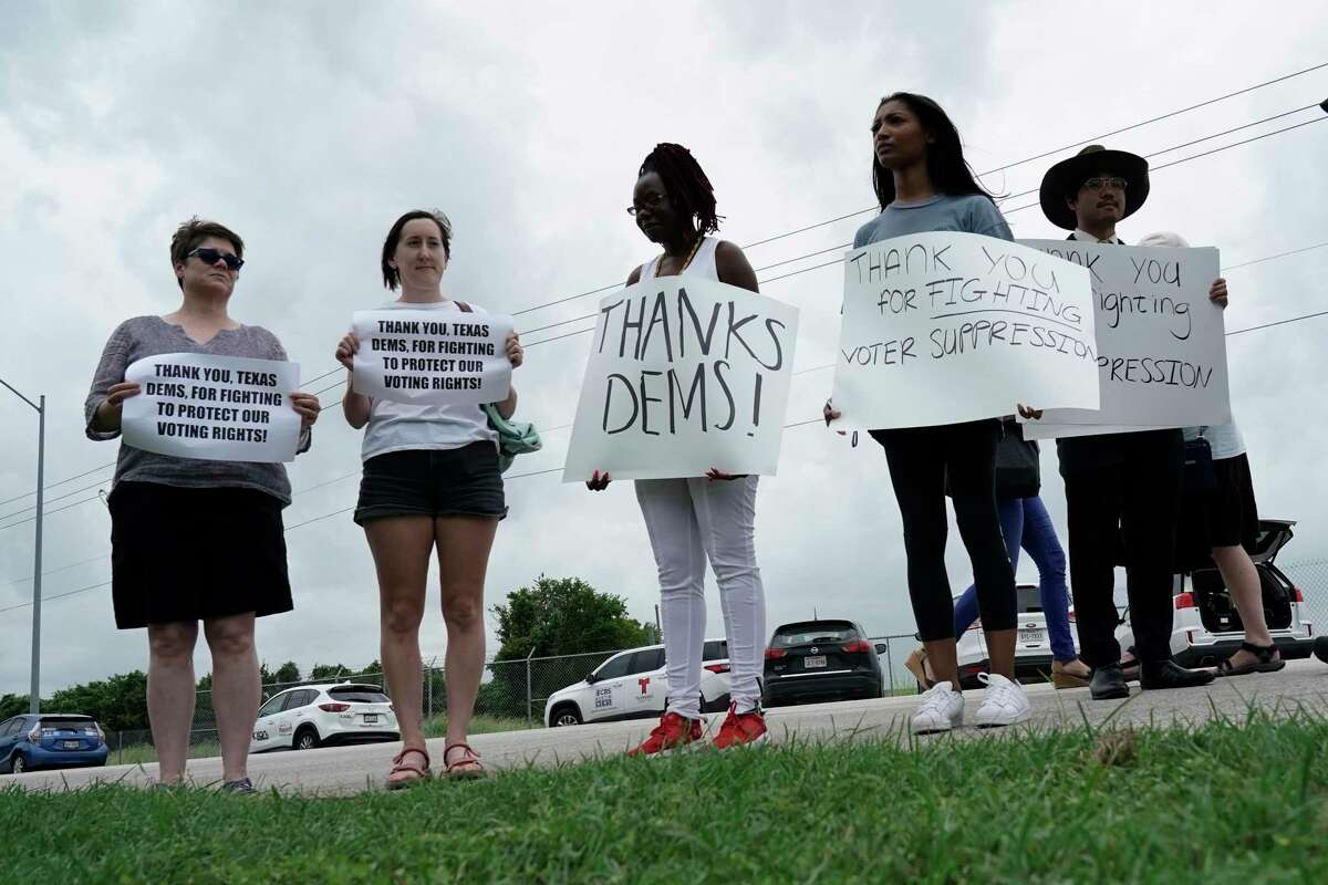 Demonstrators rally in Austin last week in support of Texas House Democrats who flew to Washington, D.C., to deny House Republicans a quorum. A reader says the Democrats did this for the benefit of all Texans, not just one political party. Another says voters should give Democrats a permanent vacation.