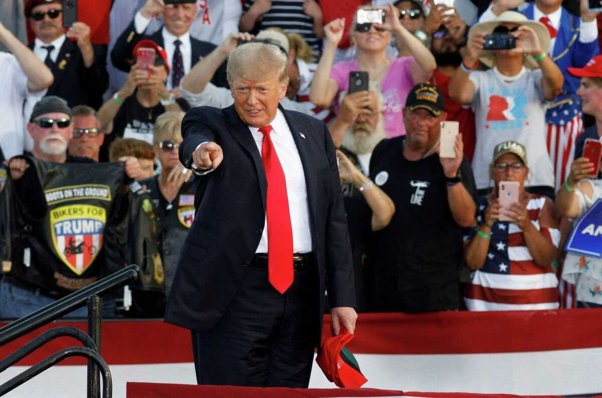 Former President Donald Trump at a rally in June in Ohio. A new book says many of Trump's most passionate fans are isolated and have found a connection and bond through the former president and his rallies.
