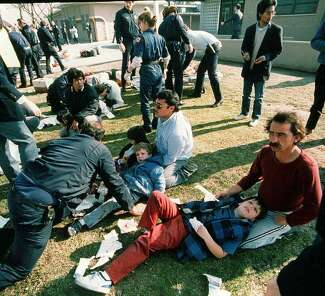 A photograph of injured children being attended to on a lawn after the Cleveland Elementary School shooting in Stockton on Jan. 17, 1989.