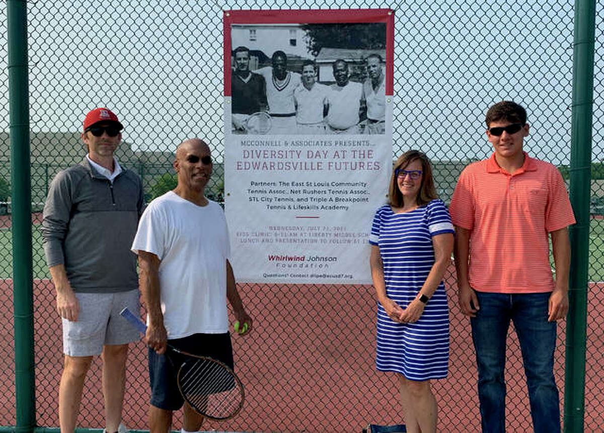 From left to right, executive member of the tournament committee Kris Lakin, Bobby Johnson, Rep. Katie Stuart and Aiden Delgado, representing McConnell and Associates, pose in front of the Diversity Day poster.