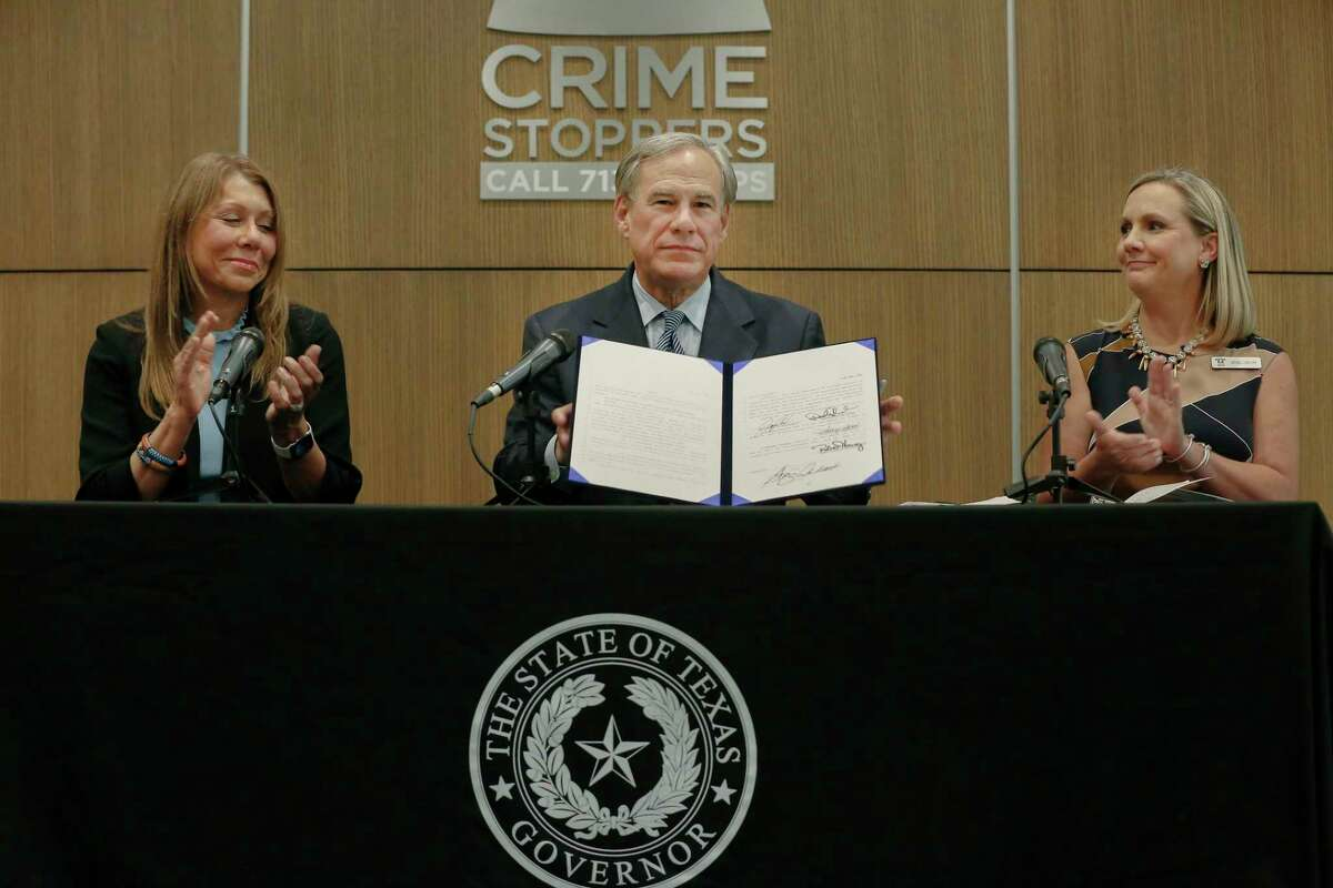 Governor Greg Abbott (center), was joined by Senator Joan Huffman (left) and Crime Stoppers of Houston Deputy Director Nichole Christoph as he ceremonially signed an anti-fentanyl legislation into law Wednesday, July 21, 2021, in Houston.