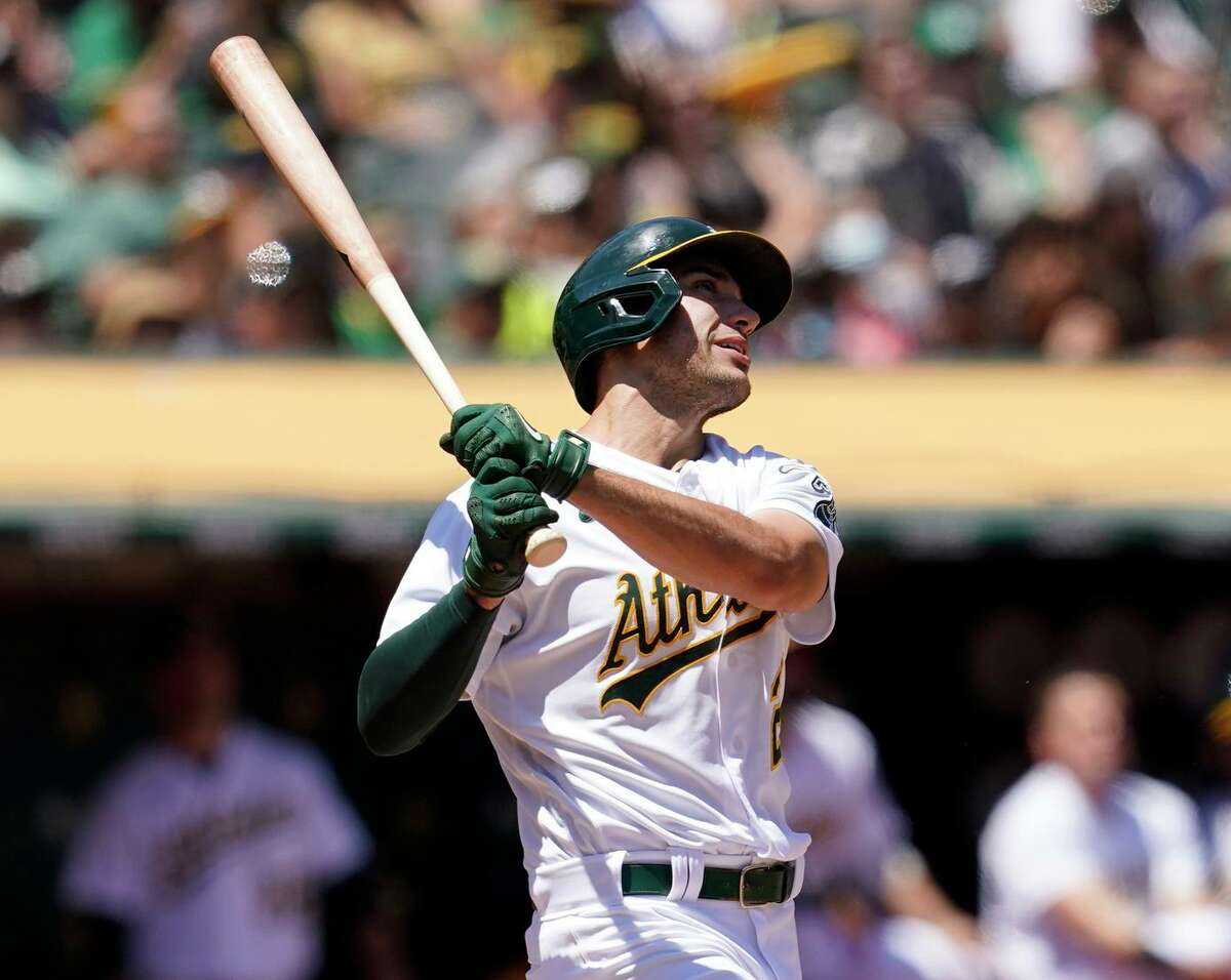 Oakland Athletics' Matt Olson hits a home run against the Los Angeles Angels during the fourth inning of a baseball game in Oakland, Calif., Tuesday, July 20, 2021. (AP Photo/Jeff Chiu)