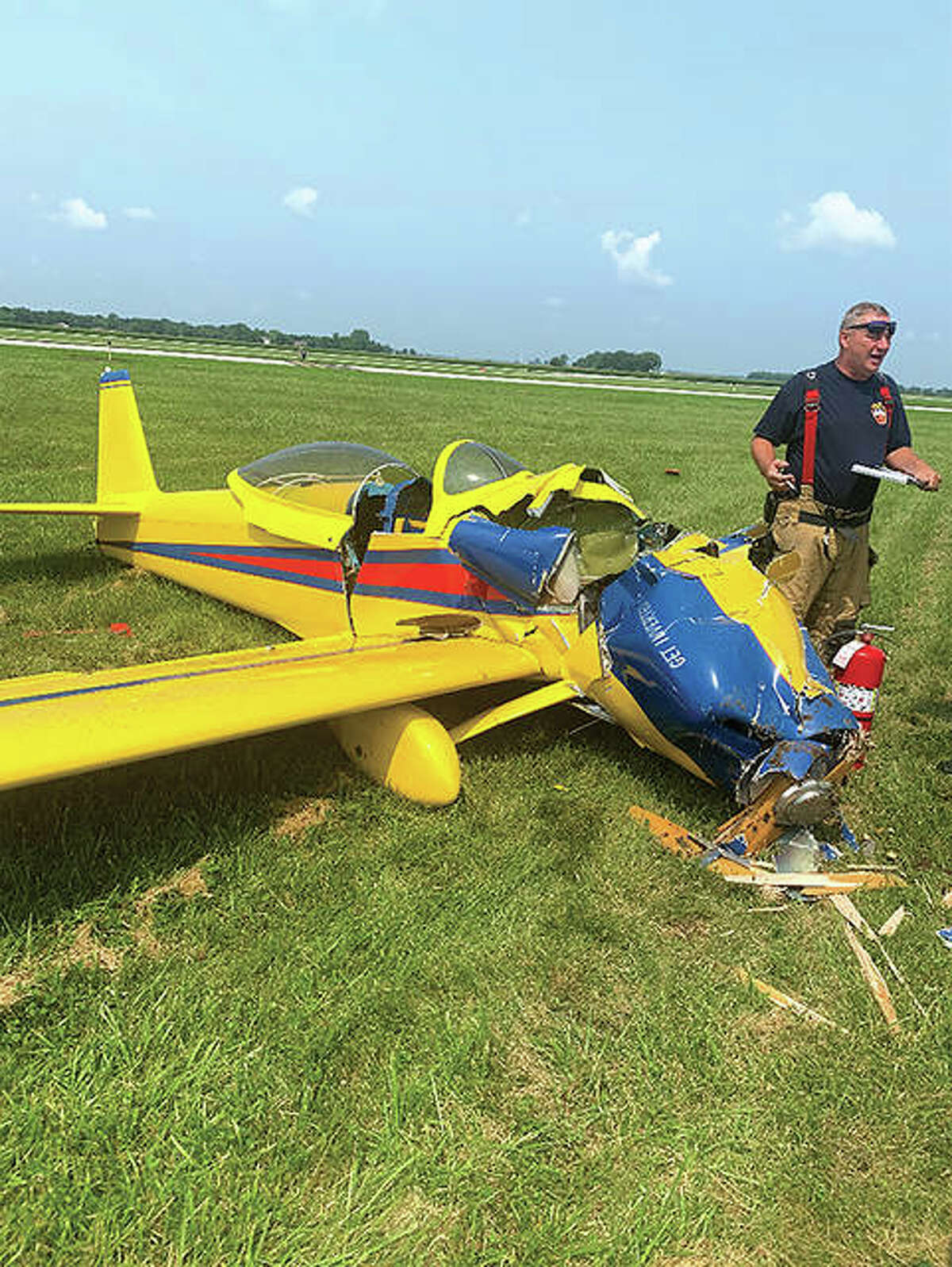 Jacksonville Fire Department Capt. Mike Martin files a report after a single-engine aircraft crashed Wednesday. The pilot, who was en route to Brooklyn, New York, declined medical treatment.