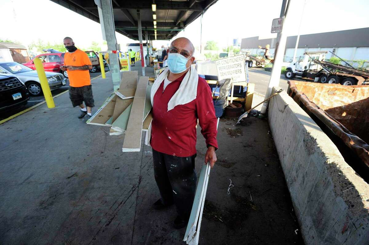 Victor Sanchez of Stamford disposes construction material at the Katrina Mygatt Recycling Center on July 25, 2020 in Stamford, Connecticut.