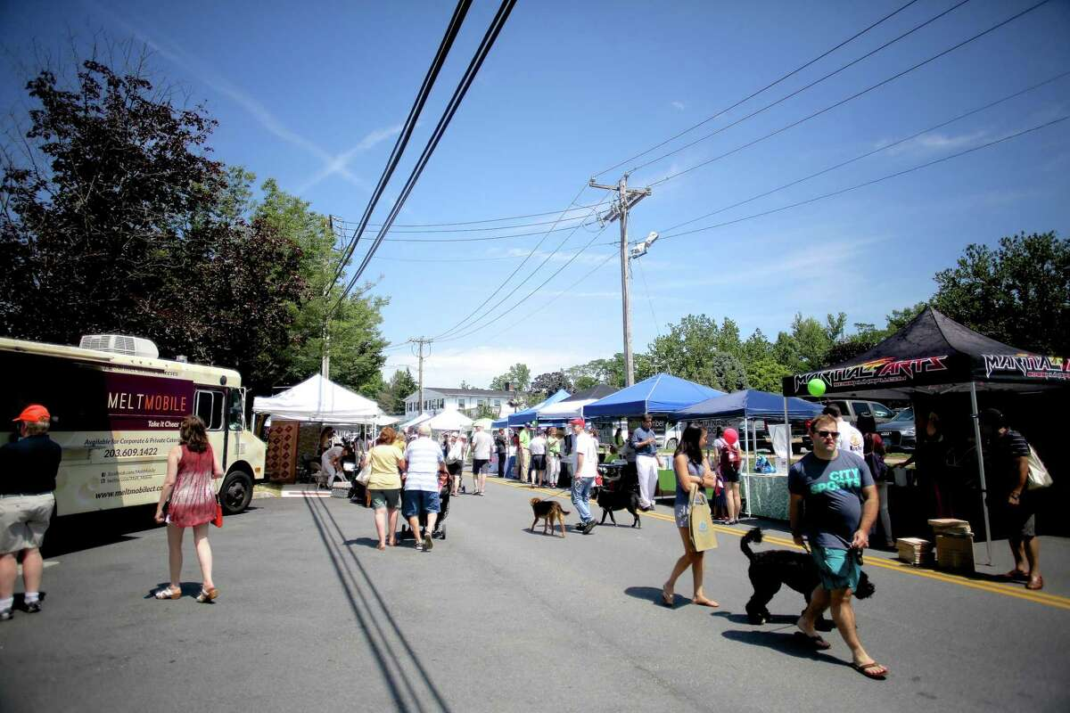 The scene of Wilton's annual street fair and sidewalk sale on Old Ridgefield Road in a previous year. A booth at the Wilton Street Fair and Sidewalk Sale on Saturday, July 24, from 10 a.m. to 3 p.m., will be that of the members of the Wilton Democratic Town Committee, (DTC,) according to an emailed newsletter from the members.