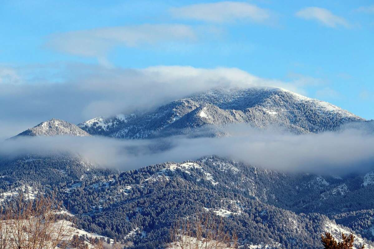 Fog along the slopes of the Bridger Mountains in the Gallatin National Forest, viewed from Bozeman, Montana.