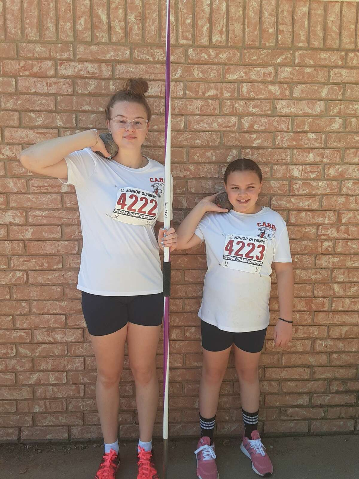 Sisters Elena, left, and Elysa Carri each qualified for the USATF National Junior Olympics earlier this month. Both qualified in the shot put in their age divisions with Elena also qualifying in the javelin.