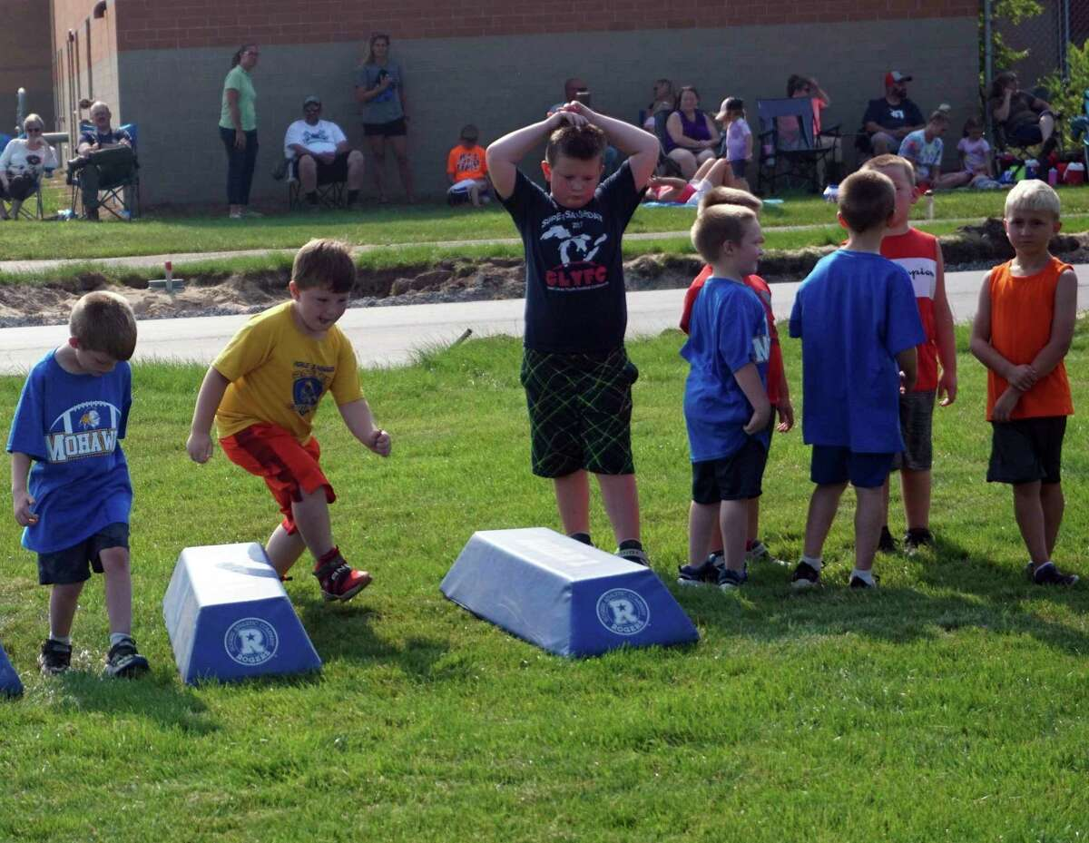 Youngsters engage in some drills late Tuesday afternoon.(Pioneer photo/Joe Judd)