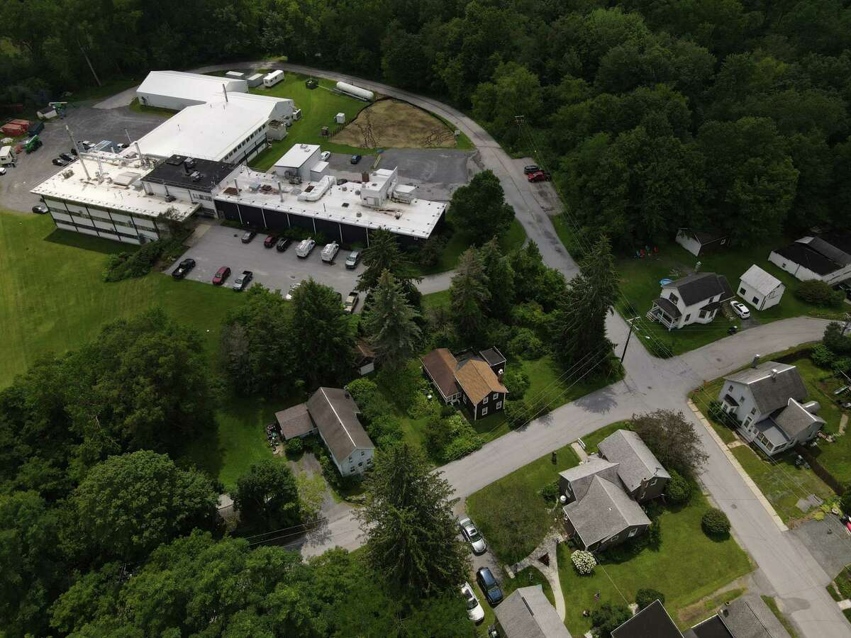 Aerial view of the Hoosick Falls Saint-Gobain factory on Wednesday, July 21, 2021, in Hoosick Falls, N.Y. Michael Hickey?•s family house in the lower center of the frame just across the street for the plant where his father once worked.