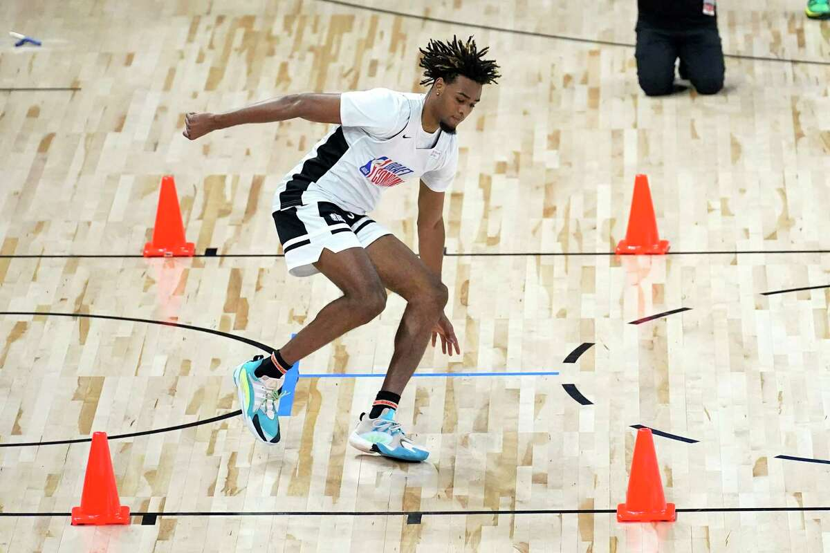 Texas' Greg Brown III participates in the NBA Draft Combine at the Wintrust Arena Tuesday, June 22, 2021, in Chicago. (AP Photo/Charles Rex Arbogast)