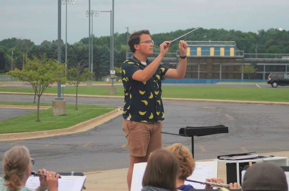 Ryan Biller conducts the Manistee Community Band during a rehearsal at Manistee Middle High School on Tuesday evening. (Kyle Kotecki/News Advocate)