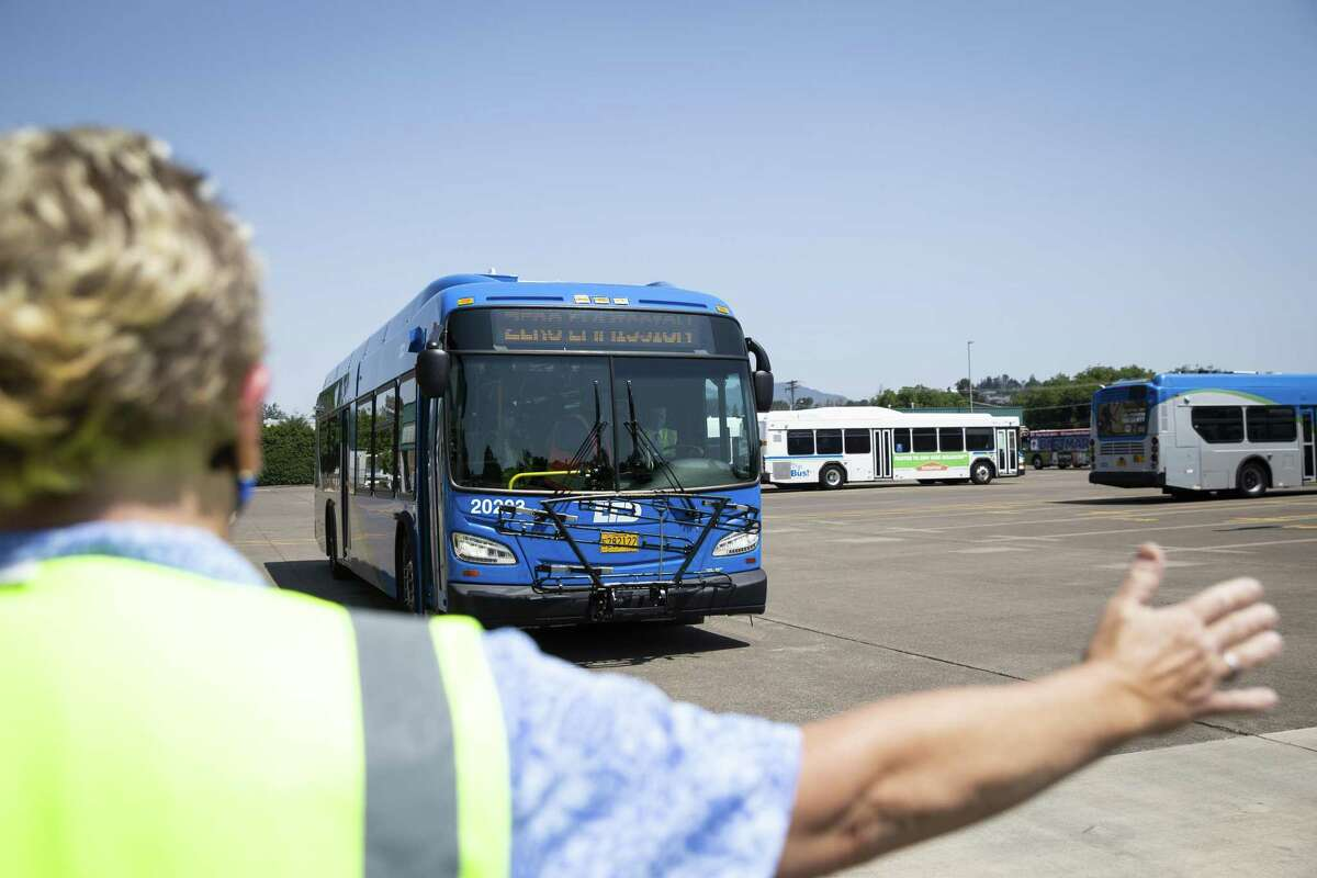Pete Buttigieg, U.S. secretary of transportation, drives an electric bus during a tour of Lane Transit District electric buses in Eugene, Ore., on July 14, 2021.