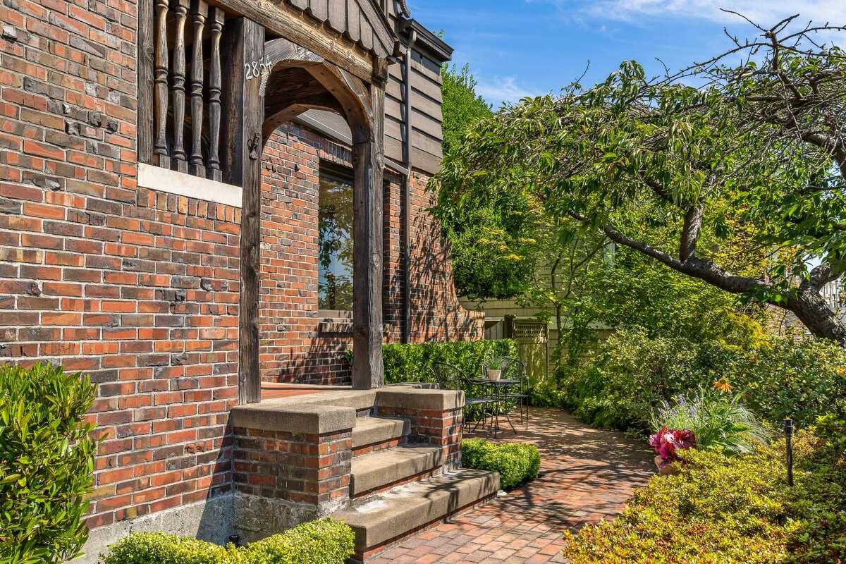 Tudor Revival design elements shine in the home's original exterior.