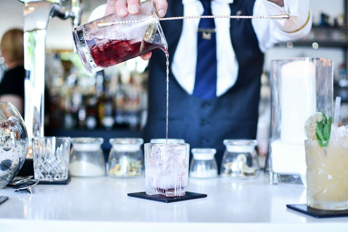 Bartender preparing a drink.