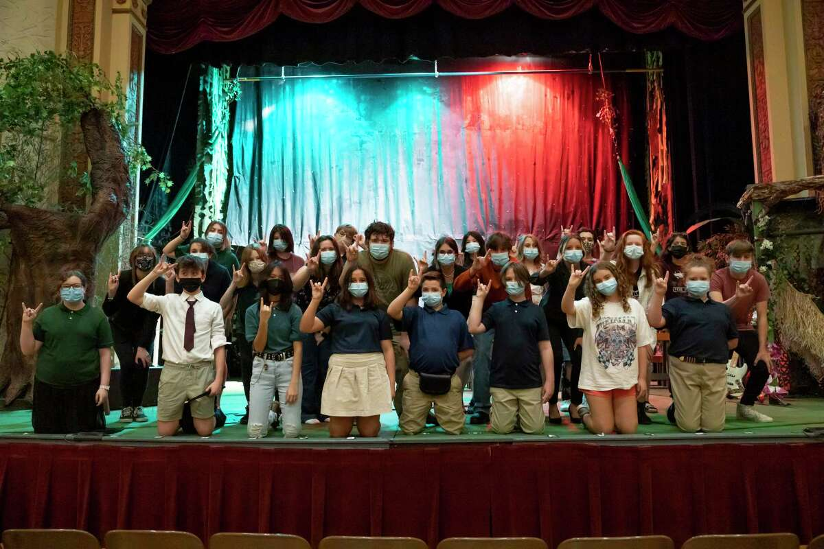 """Theater kids pose for a portrait before rehearsals for the Crighton Theatre Foundation's Youth Camp's """"School of Rock"""" production, Wednesday, July 21, 2021, in Conroe. Performances will be held Aug. 5-8 at the Crighton Theatre with kids performing between the ages of 10 to 17."""