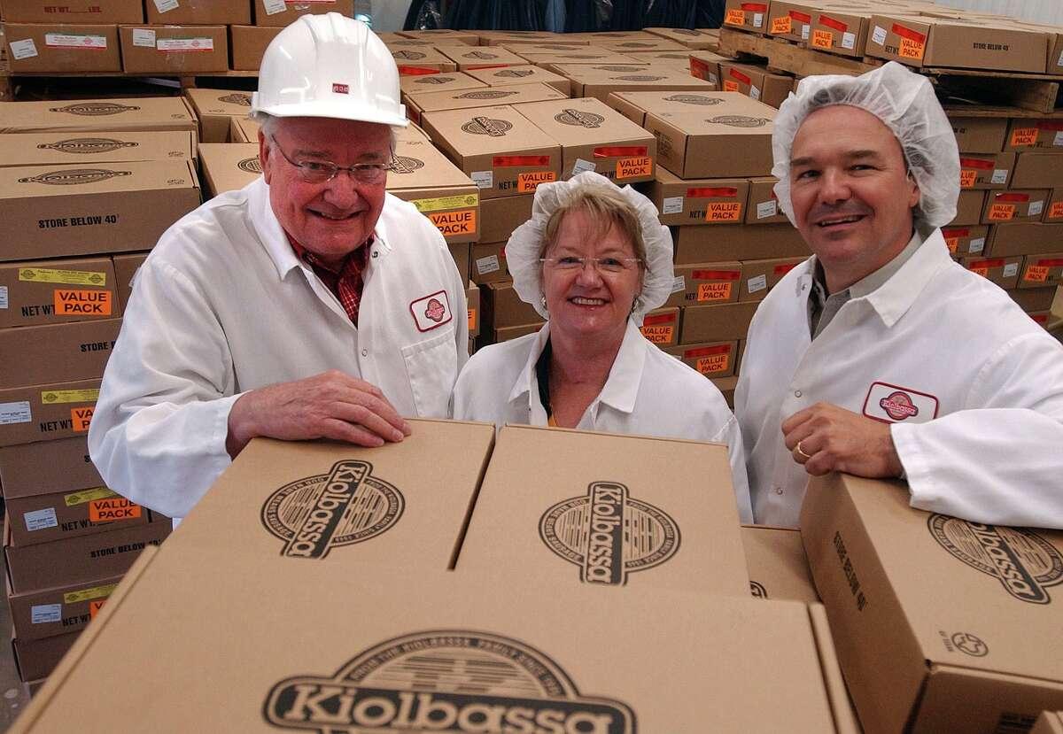 Robert (left), Sandra and Michael Kiolbassa pose at their Kiolbassa Smoked Meats sausage plant in 2005.