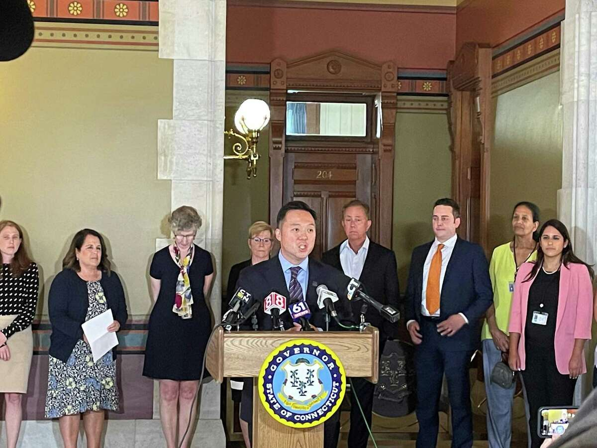 Connecticut Attorney General William Tong, center, speaks during a press conference at the state Capitol on Wednesday, July 21, 2021 to announce Connecticut's participation in a $26 billion national settlement with AmerisourceBergen, Cardinal Health, McKesson and Johnson & Johnson related to their alleged roles in the opioid crisis.