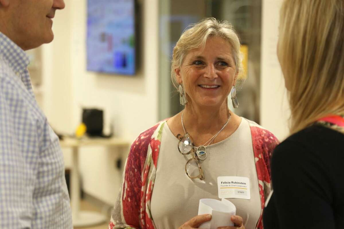 Felicia Rubinstein, founder and chief collaborator with Hayvn talks with associates at the Female Founder Pitch Night.