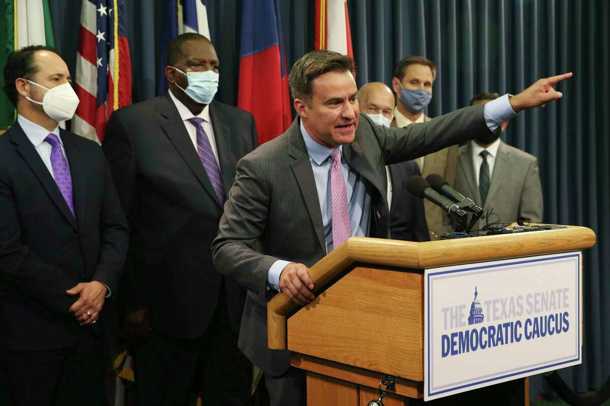 Texas State Sen. Roland Gutierrez, (D-San Antonio), addresses the media during a press conference by the Senate Democratic caucus at the State Capitol, Wednesday, July 21, 2021. On the left is Sen. Jose Menendez, (D-San Antonio) and Sen. Royce West, (D-Dallas).