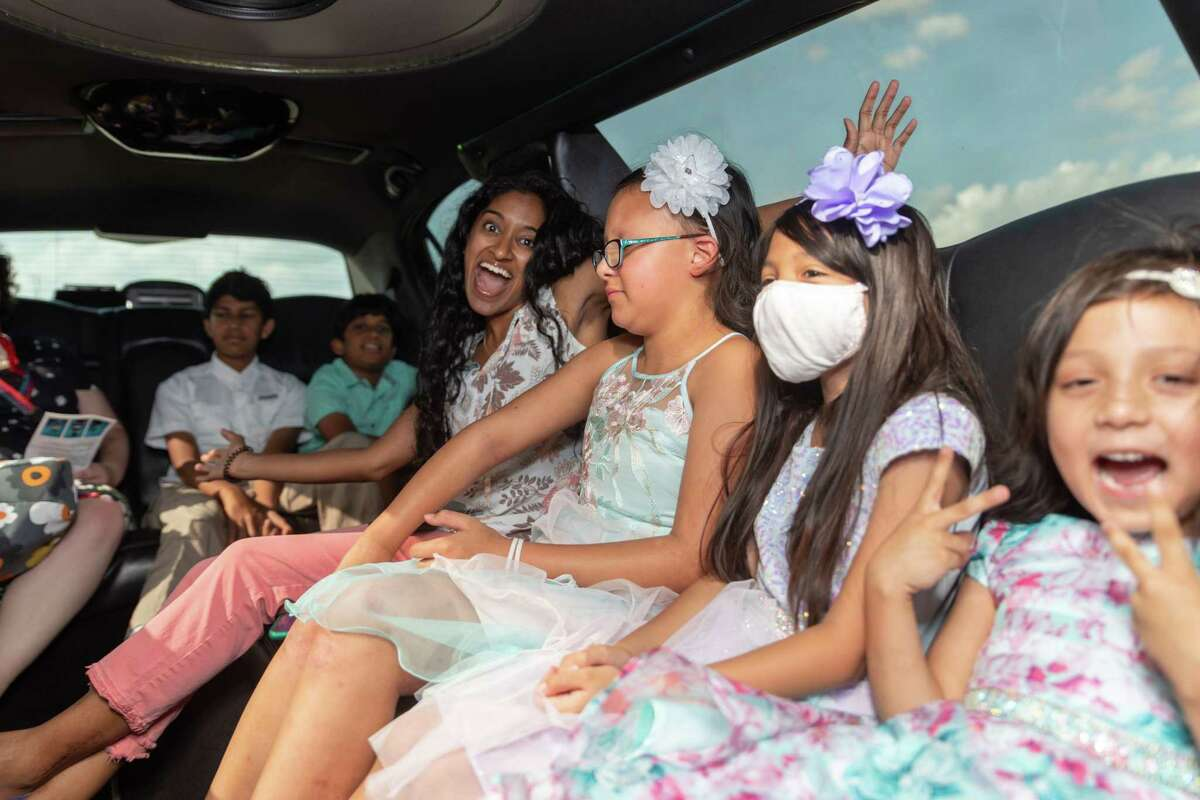 Attendees ride in a limo during an event hosted by nonprofit A Children's House for the Soul and skincare brand CeraVe on Saturday, July 17, at Star Cinema Grill in Richmond. The event aimed to encourage children with skin conditions and educate others.