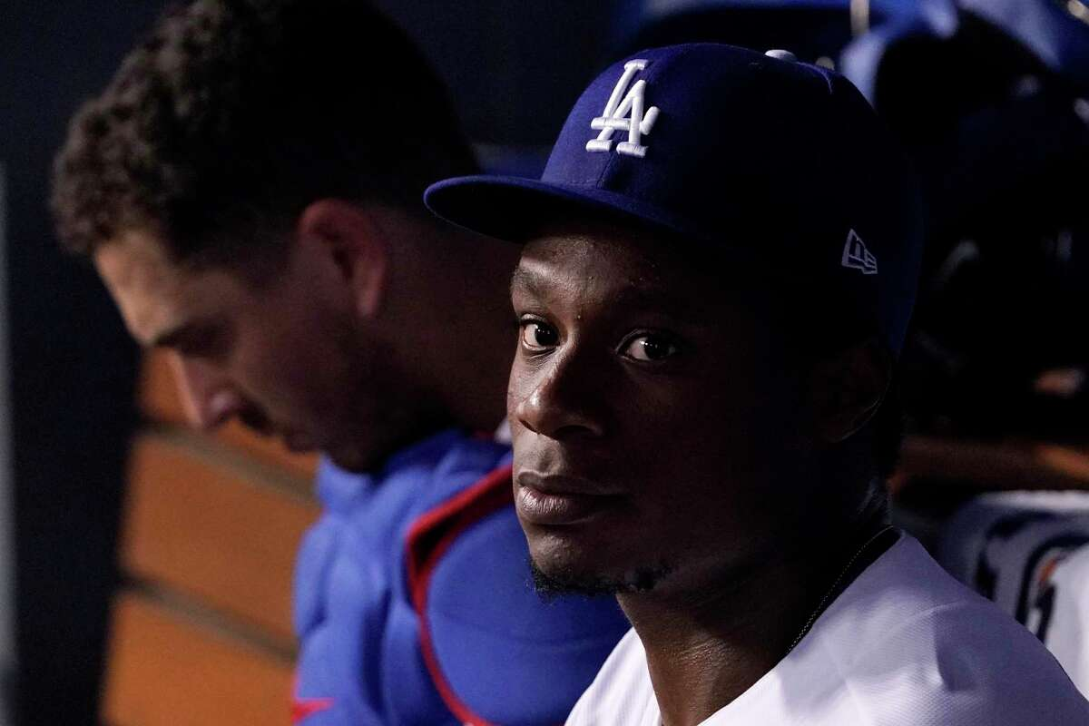 Los Angeles Dodgers relief pitcher Josiah Gray, right, sits in the dugout with catcher Austin Barnes during the third inning of a baseball game against the San Francisco Giants Tuesday, July 20, 2021, in Los Angeles. (AP Photo/Mark J. Terrill)