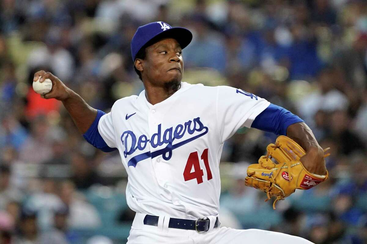 Los Angeles Dodgers relief pitcher Josiah Gray throws to the plate during the third inning of a baseball game against the Los Angeles Dodgers Tuesday, July 20, 2021, in Los Angeles. (AP Photo/Mark J. Terrill)