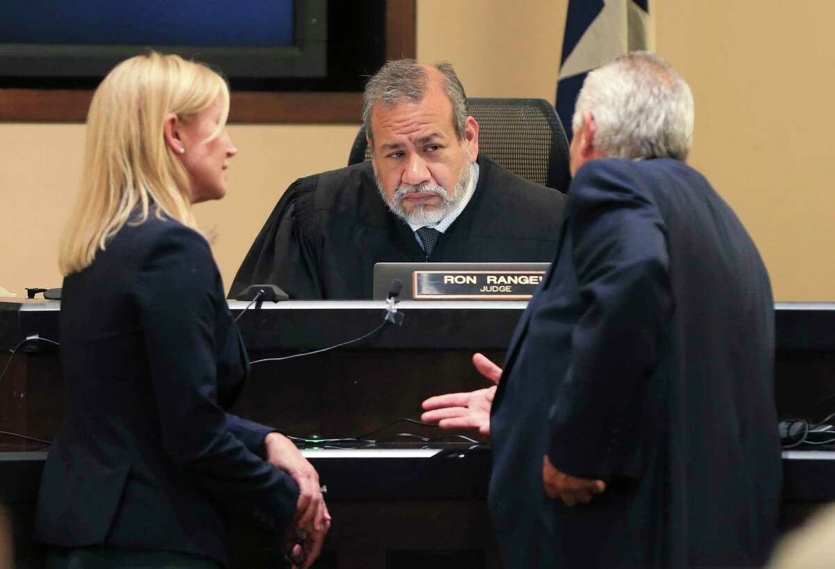 Judge Ron Rangel listens to a discussion between Prosecutor Tamara Strauch (left) and Defense Attorney Raymond Fuchs as witnesses testify on the eighth day of Otis McKane's trial.