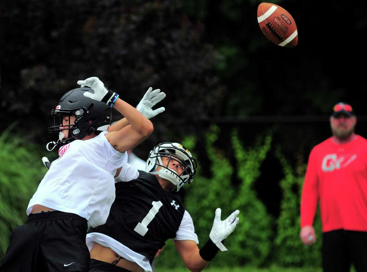 Trumbull's Owen Solano (1) misses a touchdown pass during Grip It and Rip It 7-on-7 football tournament action in New Canaan, Conn., on Saturday July 10, 2021.