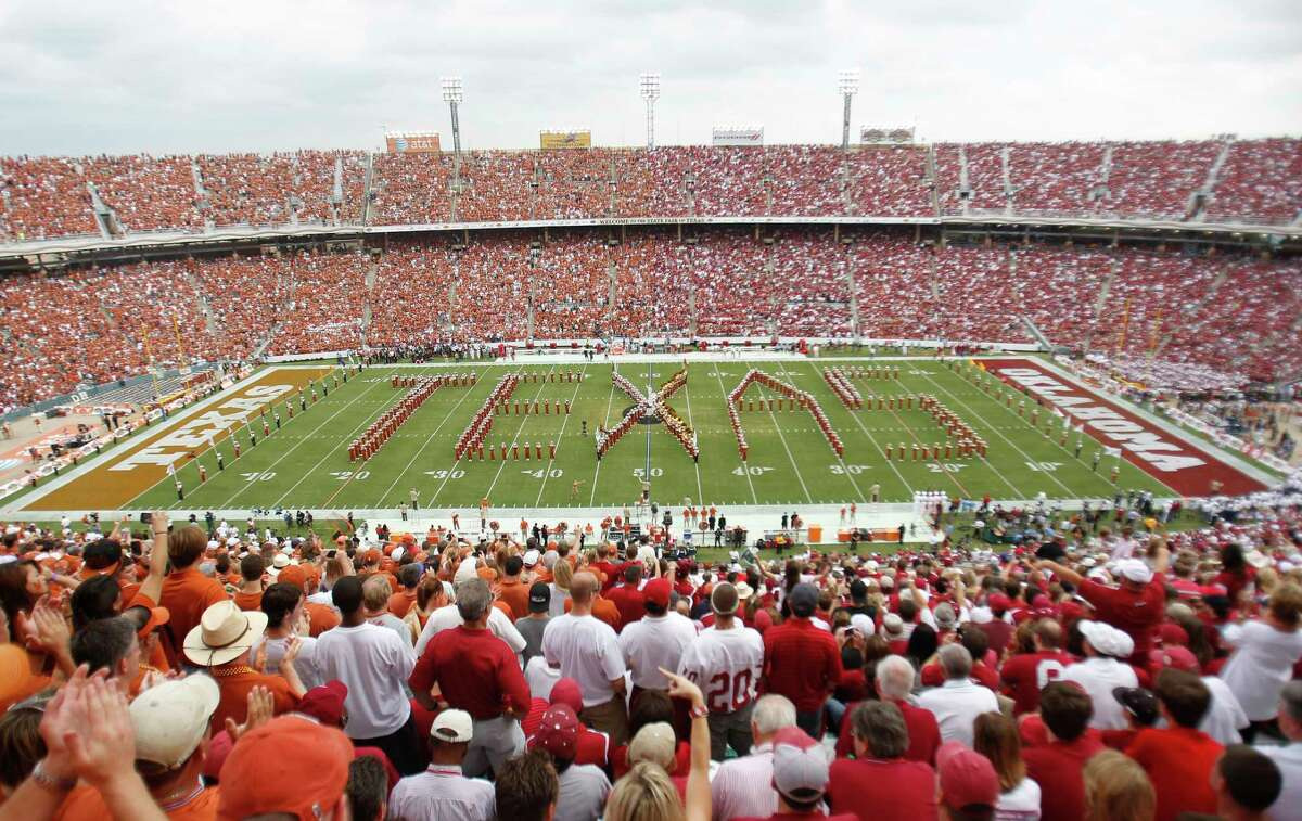 In this Oct. 8, 2011, file photo, Texas fans, left, and Oklahoma fans, right, fill the Cotton Bowl for the NCAA college football game between Oklahoma and Texas in Dallas.