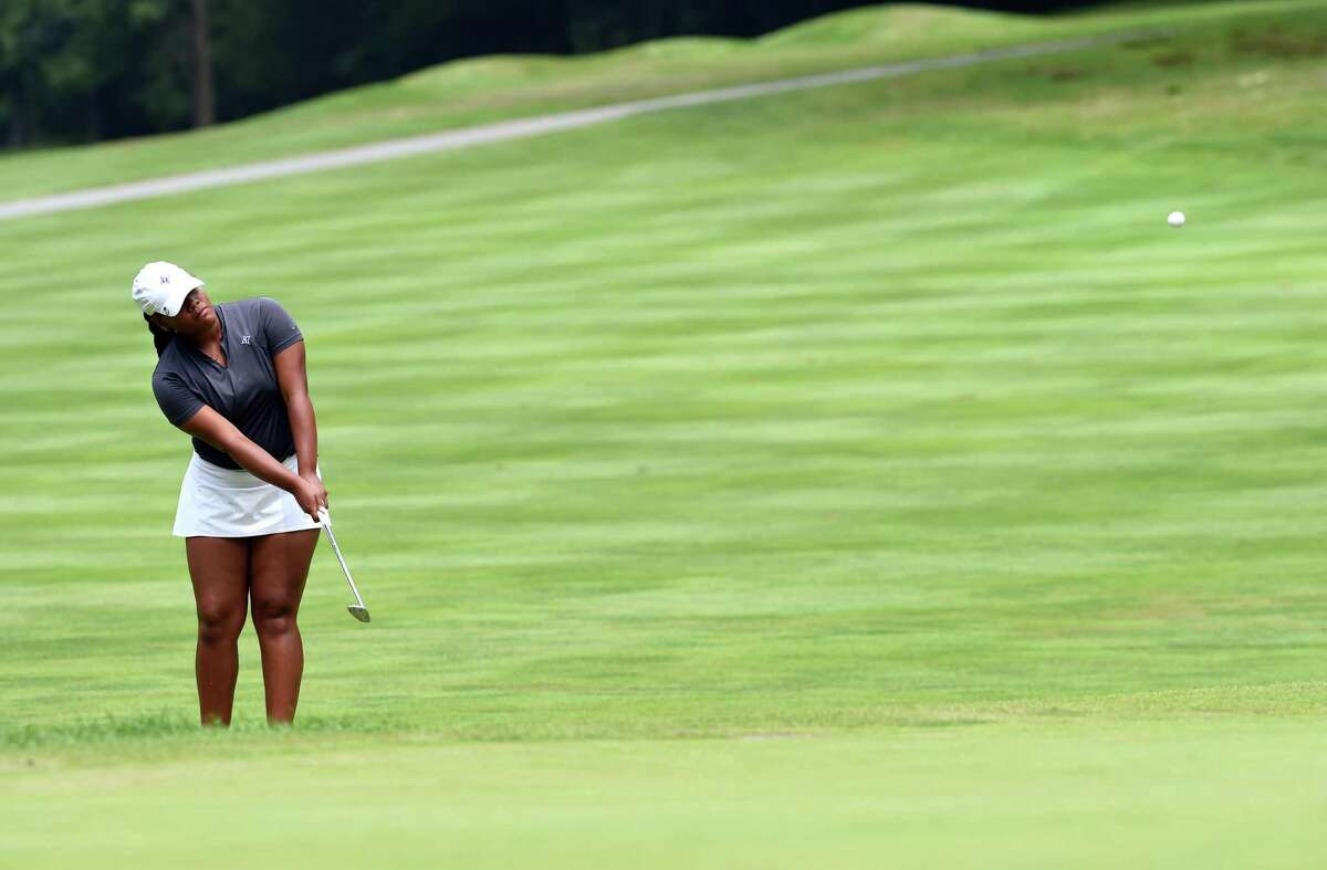 Kyra Cox hits hits onto the green on the 10th hole in the final round of the Connecticut Women's Amateur Championship at Race Brook Country Club in Orange on Wednesday.