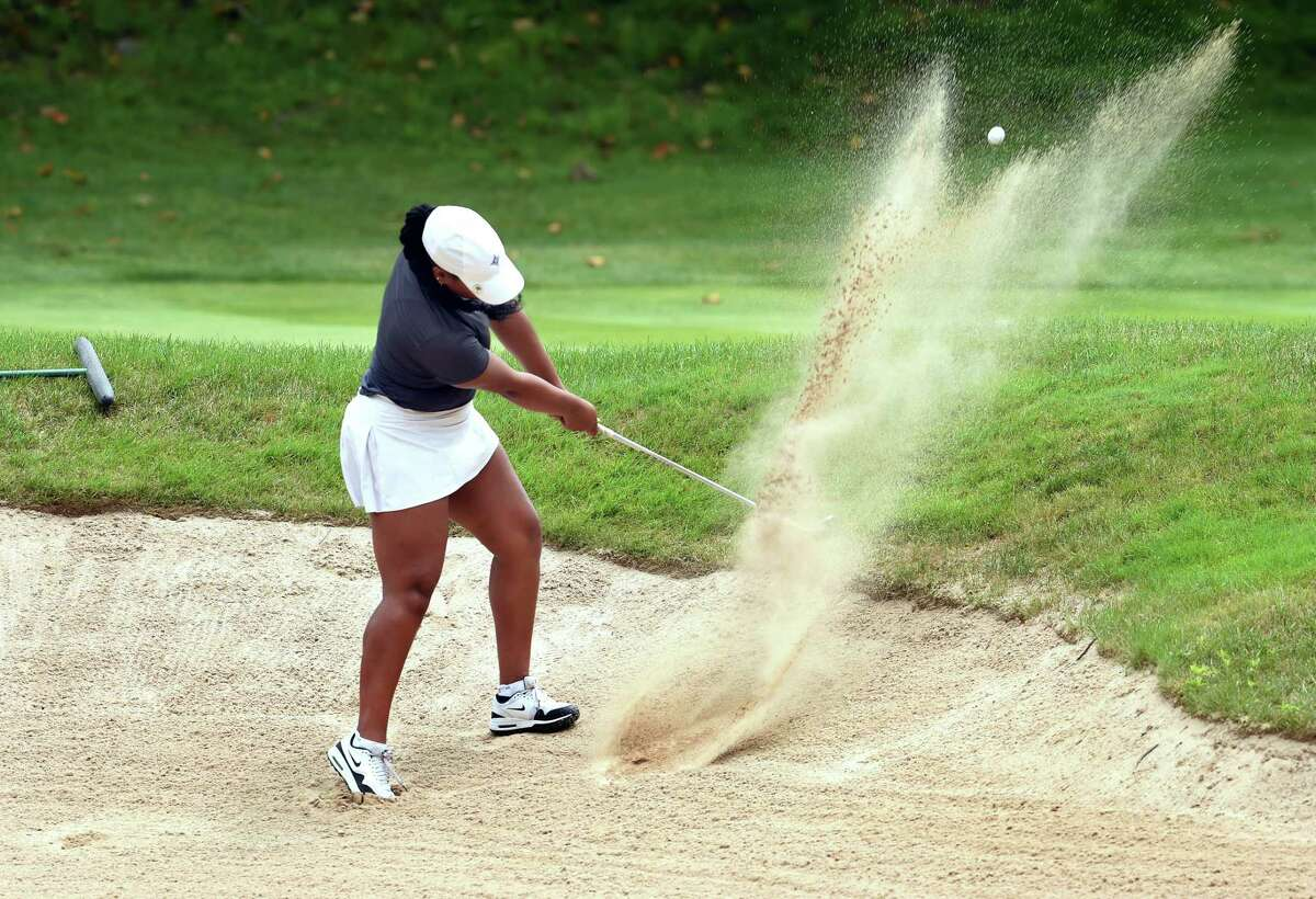 Kyra Cox hits hits out of a sand trap on the 10th hole in the final round of the Connecticut Women's Amateur Championship at Race Brook Country Club in Orange on Wednesday.